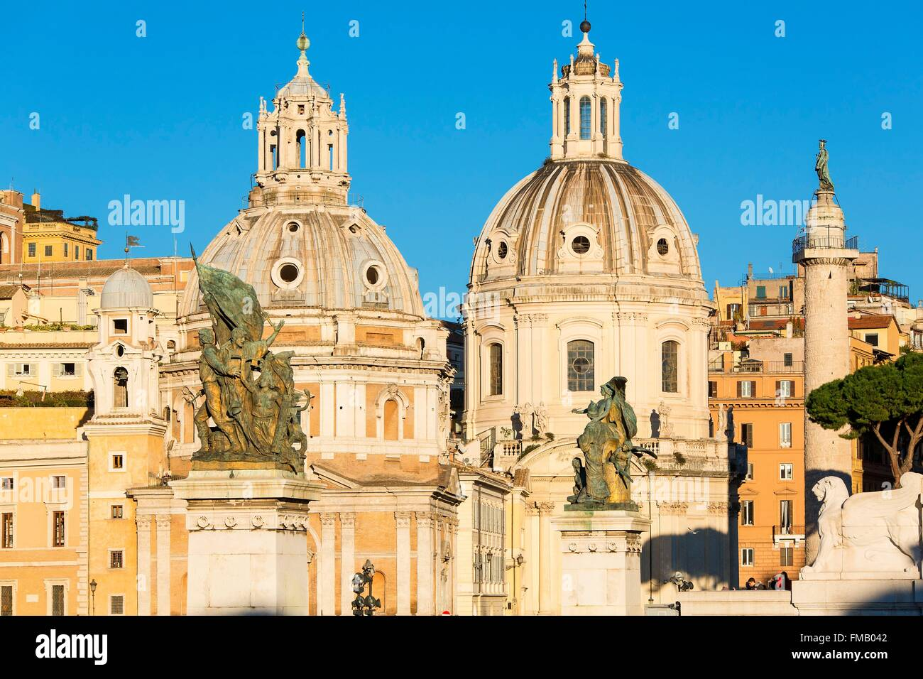 Italy, Lazio, Rome, historical center listed as World Heritage by UNESCO, the Trajan's column and the cupolas of Stock Photo