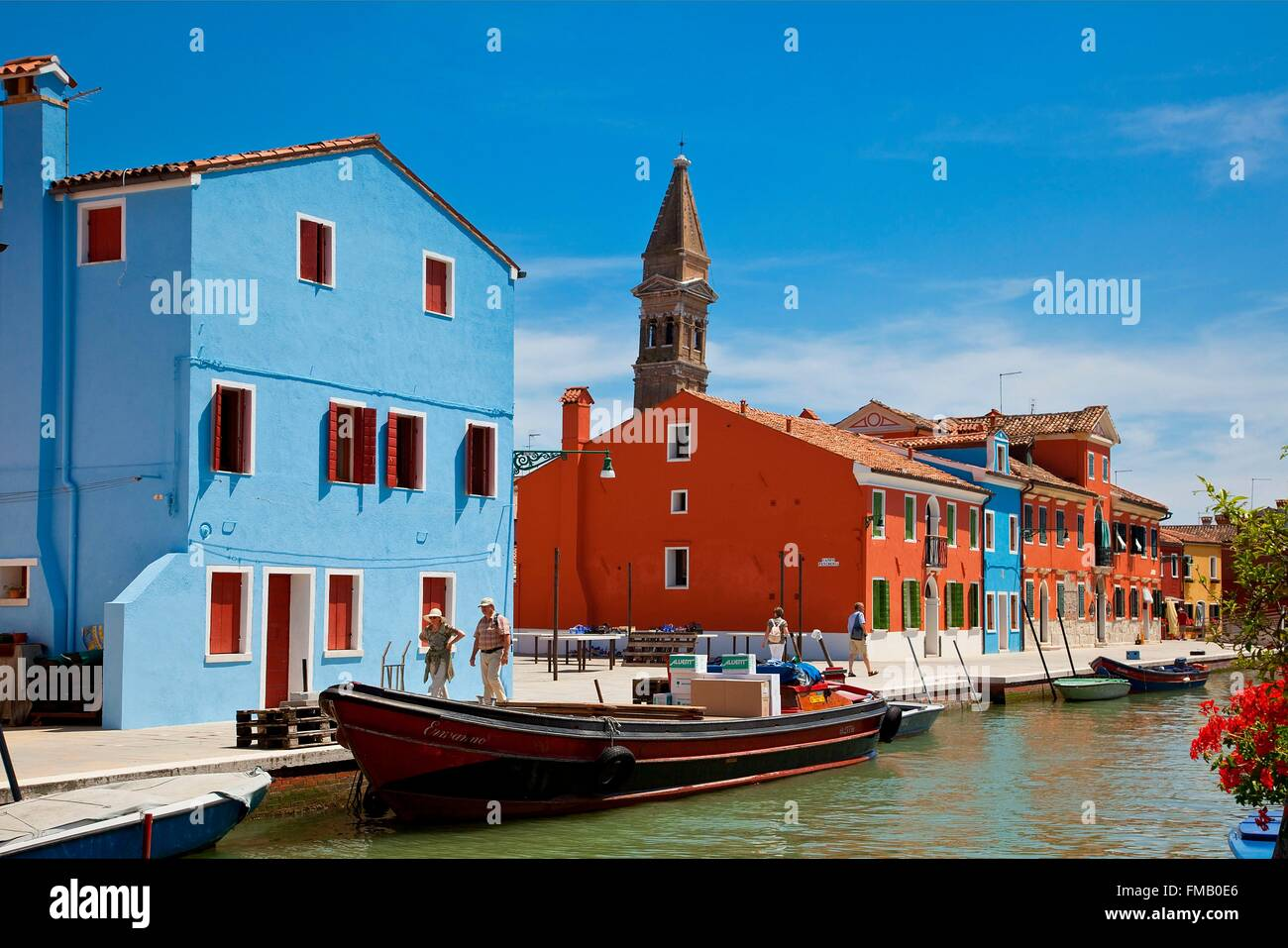 Italy, Veneto, Venice, Colorful Boats and Homes Lining Canal in Burano - Stock Image