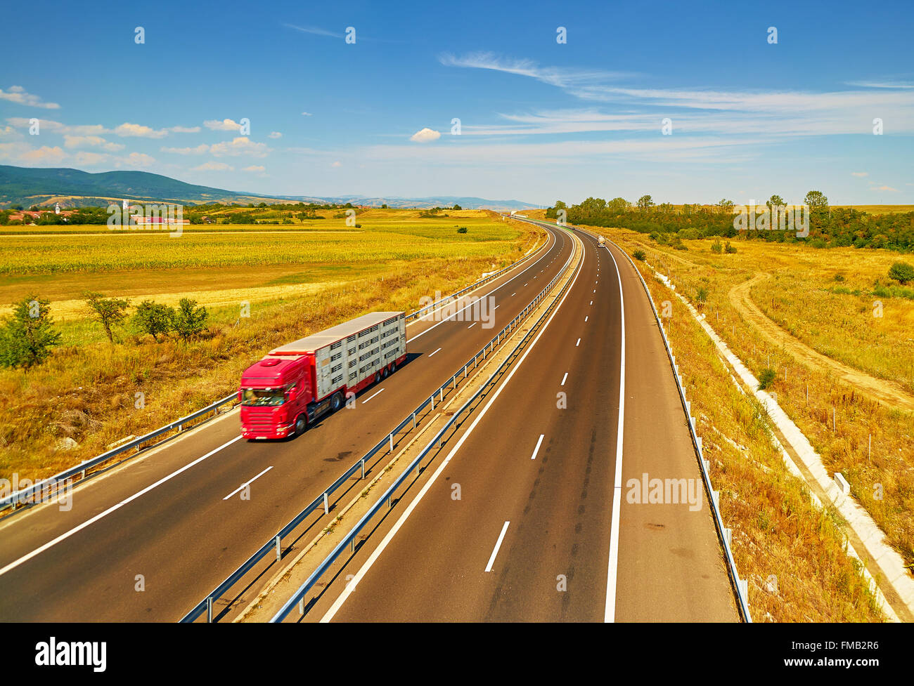 Freight Truck on Highway- Transportation Background - Stock Image
