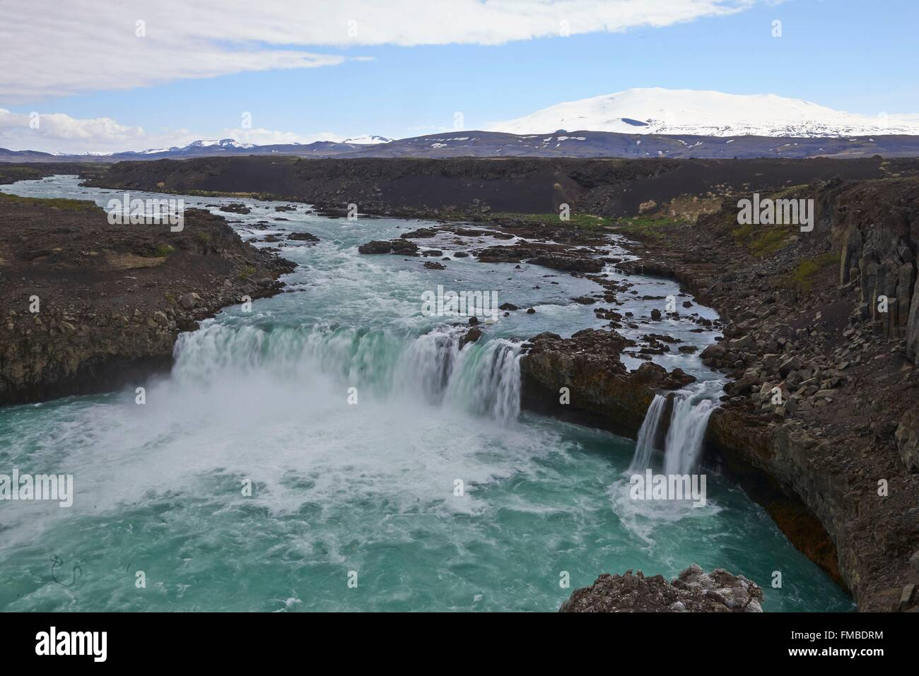 Iceland, Golden Circle, wild landscape with lava field, Hekla volcano, river and waterfall - Stock Image