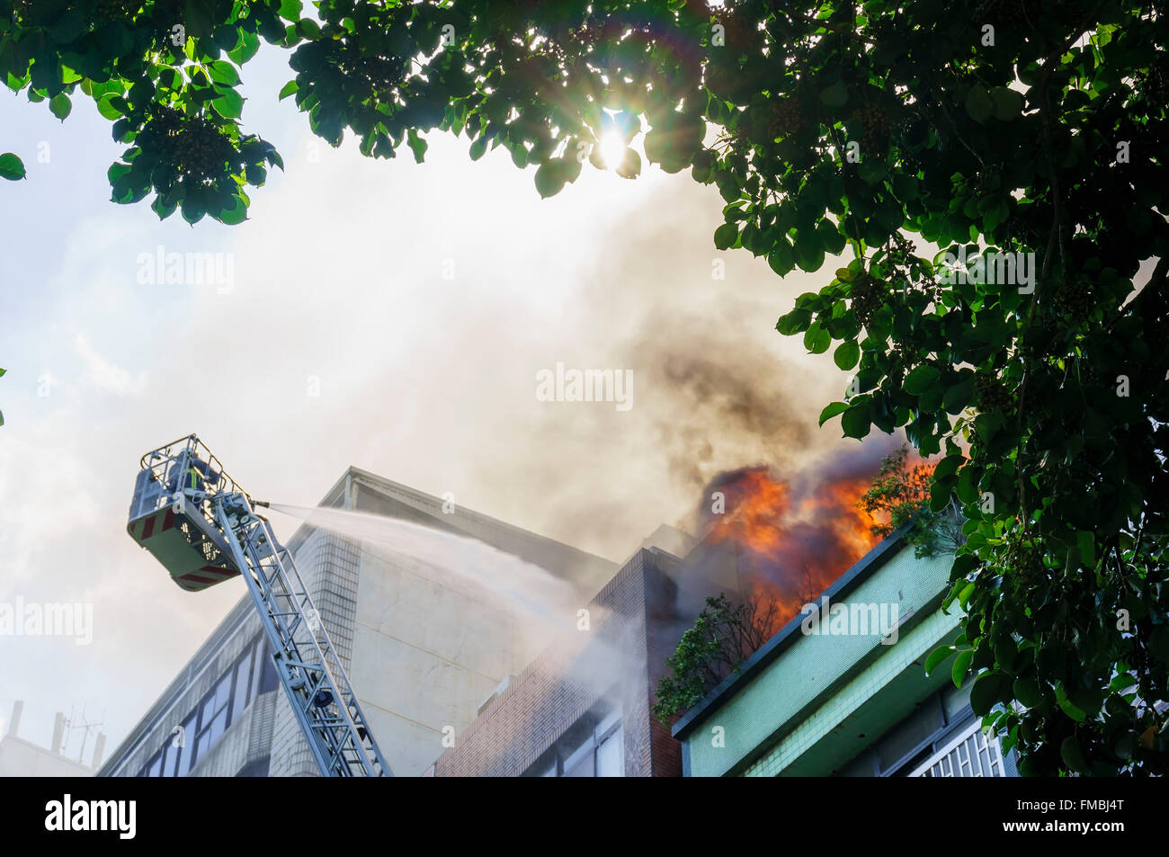 Fire fighter is fighting against the fire disaster at Taipei, Taiwan - Stock Image