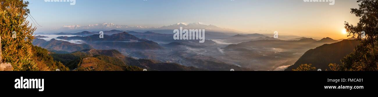 Nepal, Gandaki zone, Bandipur, sunrise on the Annapurna and Manaslu mountains and mist in the valley - Stock Image