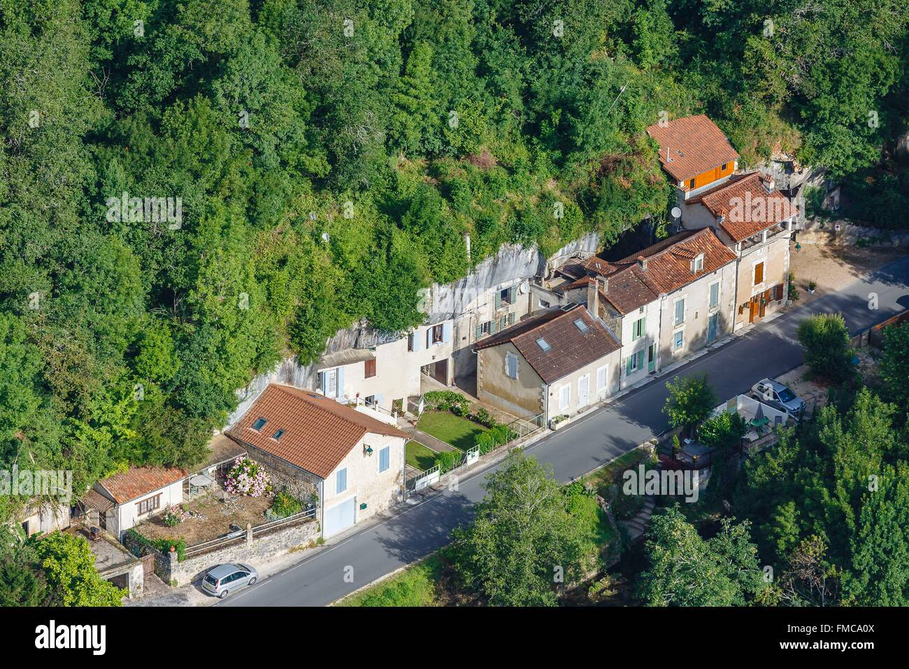 France, Dordogne, Brantome, cave dwellings (aerial view) - Stock Image