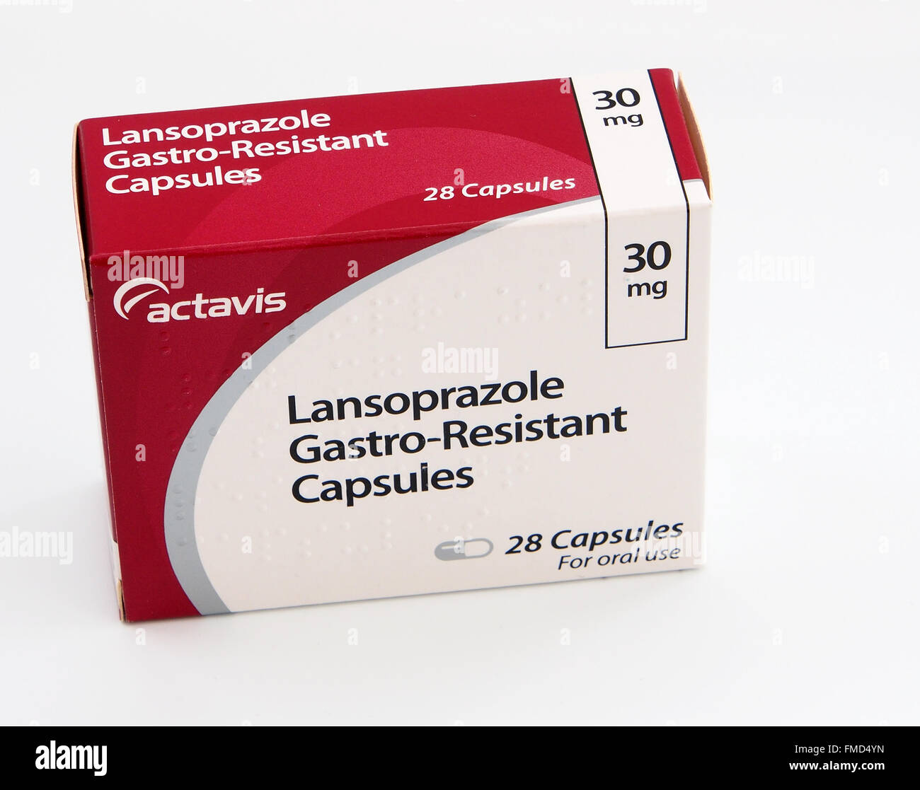 A box of Lansoprazole with the blister packs in front.  This drug is one of a group known as proton pump inhibitors. - Stock Image