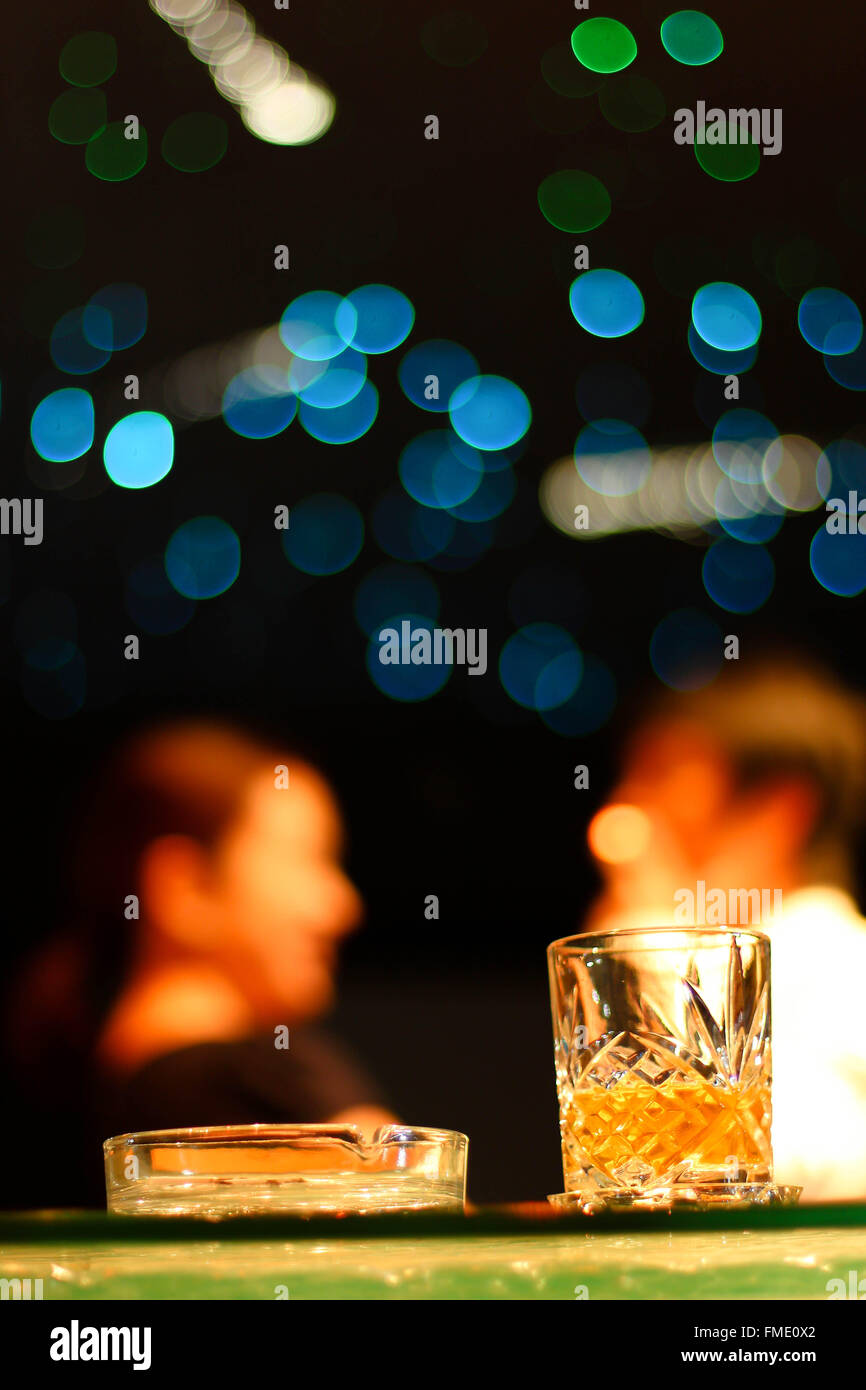 Couple having a drink in the bar after work - Stock Image