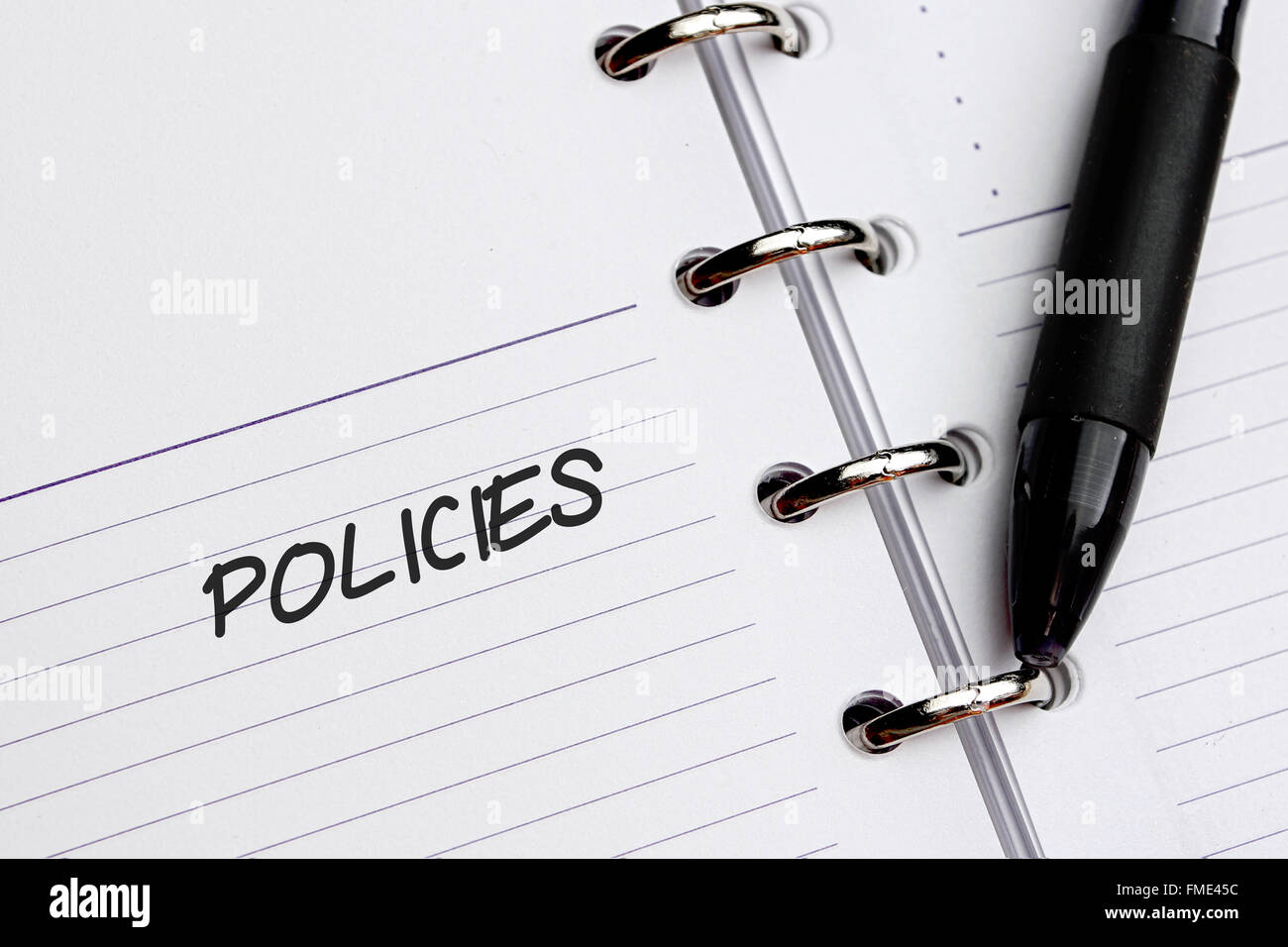Policies word written on paper - Stock Image