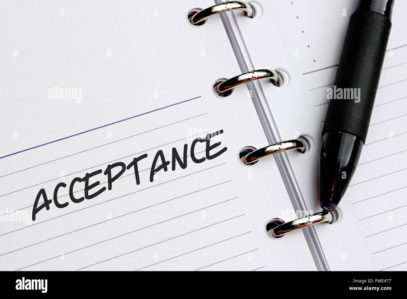 Acceptance word written on paper - Stock Image