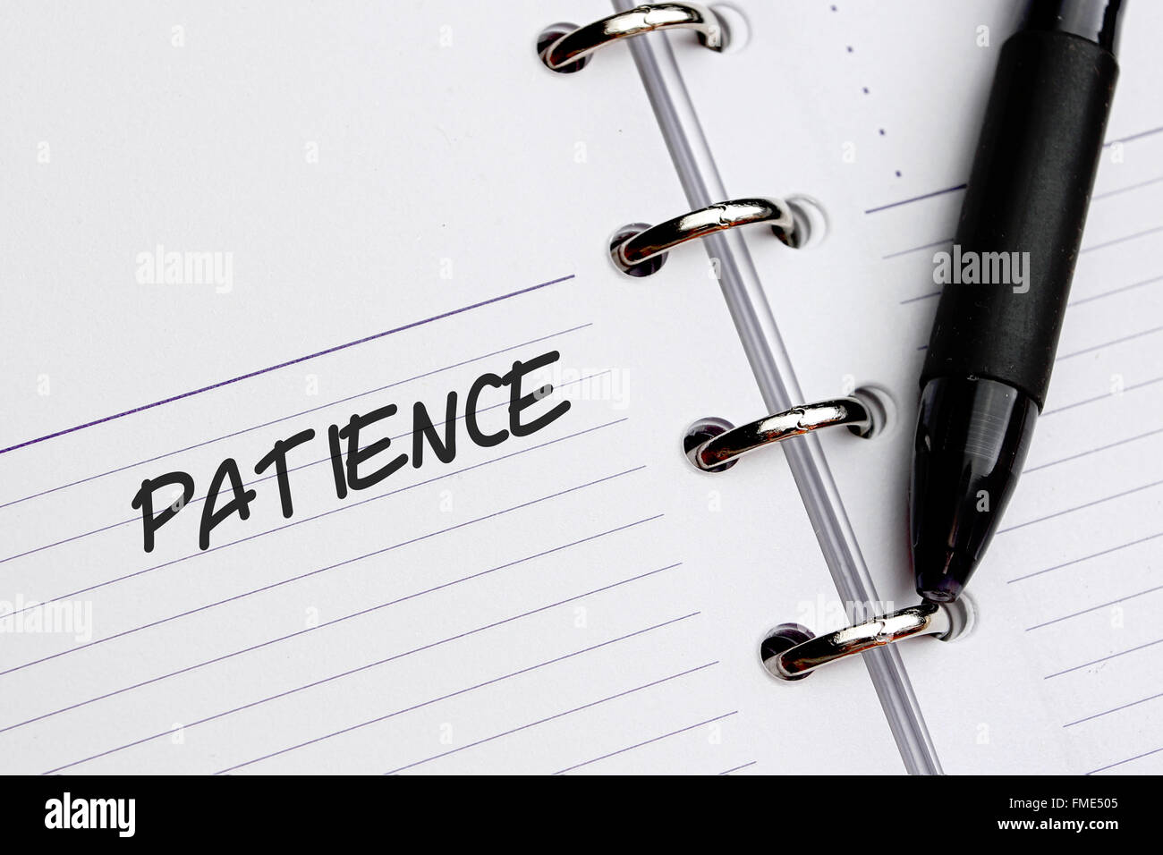 Patience word written on paper - Stock Image