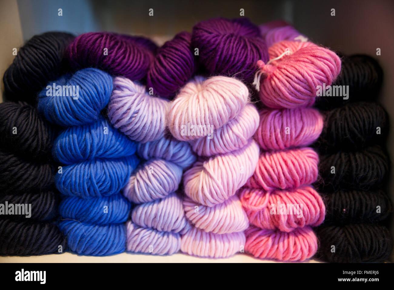 Colorful skeins of yarn on display. - Stock Image