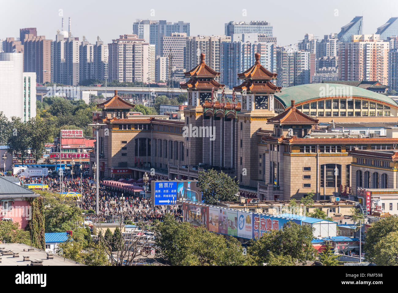 A Lot of people on the square in front of the Beijing Railway Station, Beijing, China - Stock Image