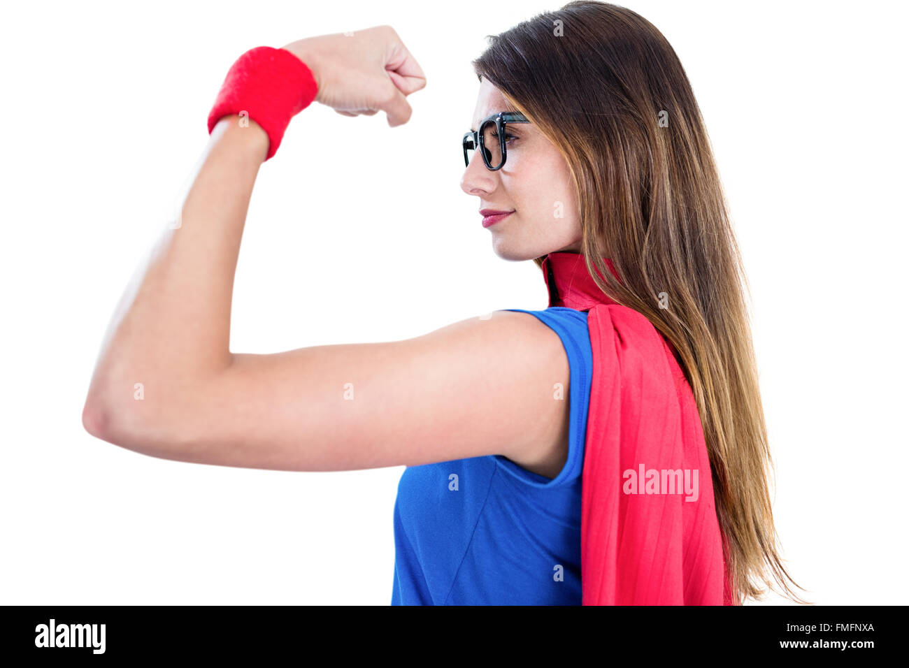 Woman in superhero costume while flexing muscles  sc 1 st  Alamy & Woman in superhero costume while flexing muscles Stock Photo ...