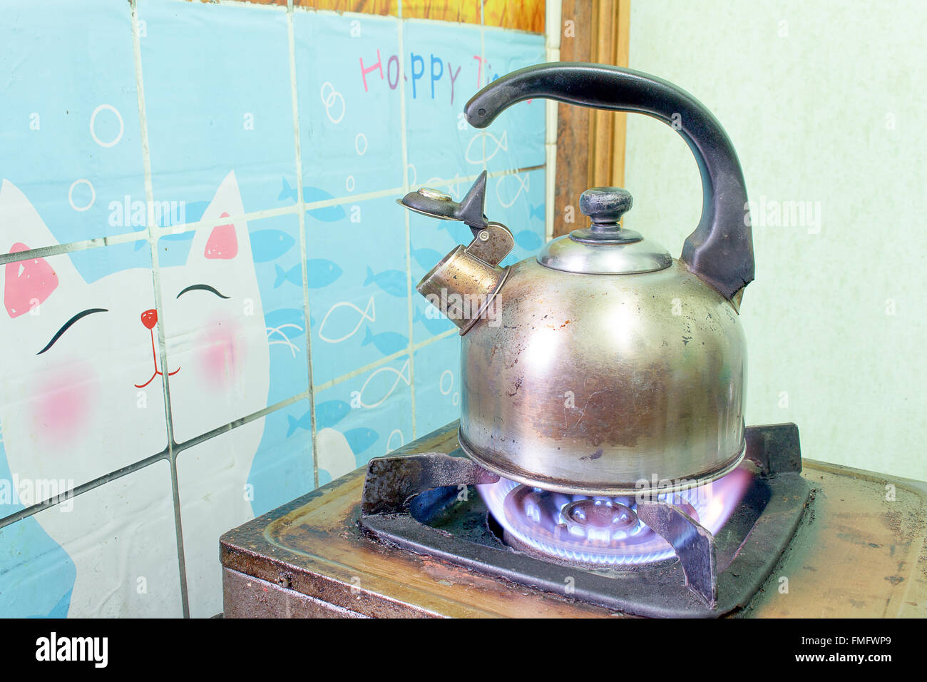 steel Kettle old boils  on a gas stove - Stock Image