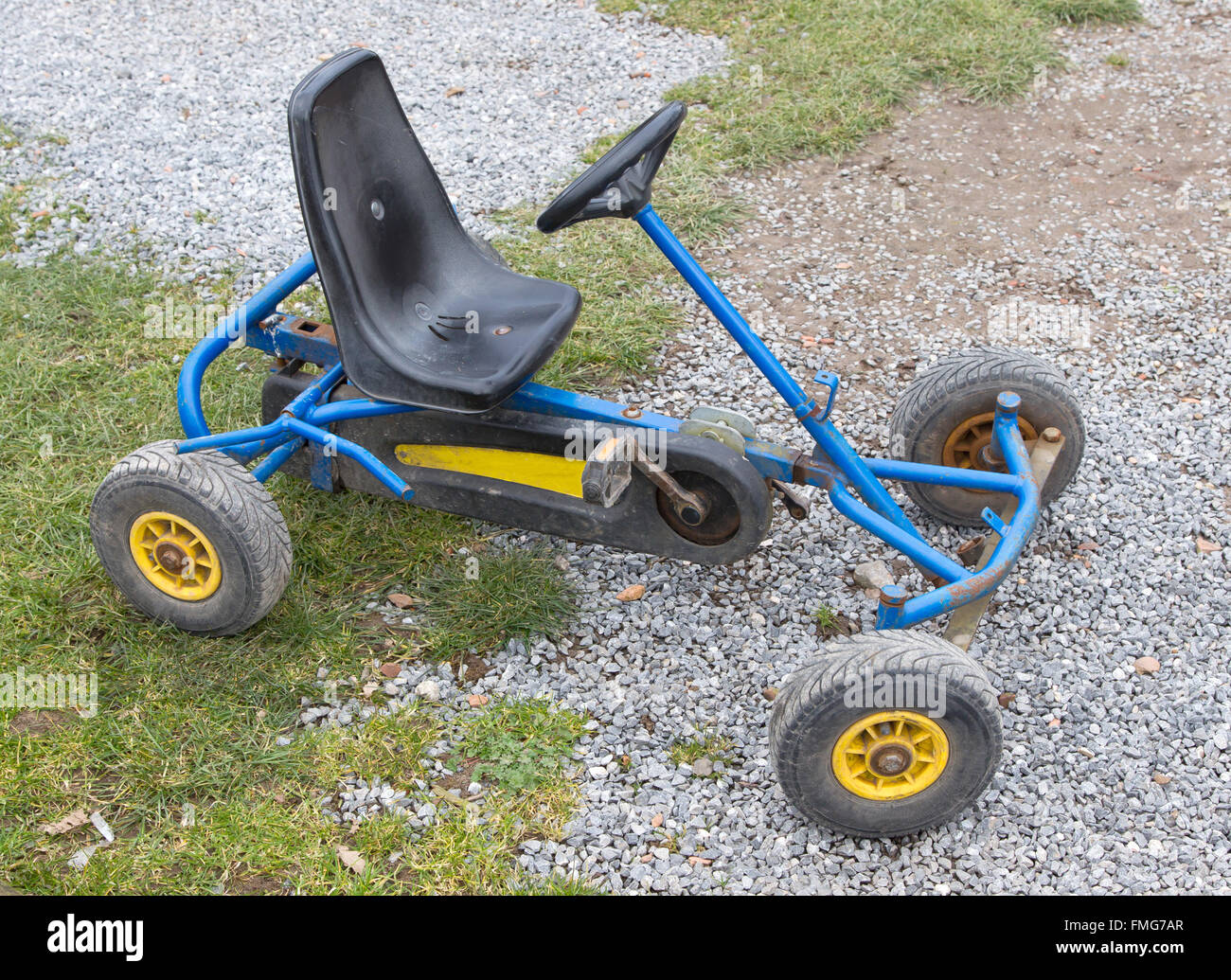Dirty old go-kart waiting for a kid to play with it Stock