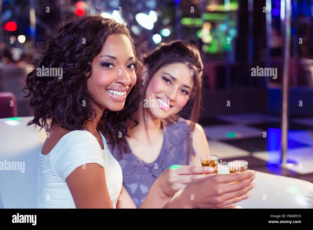 Pretty girls having shots - Stock Image