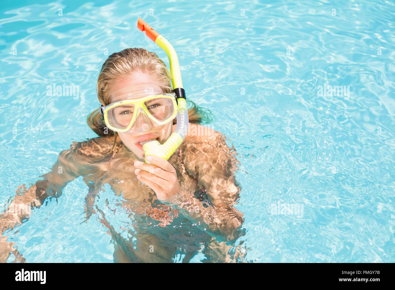Portrait of woman with snorkel gear swimming in pool Stock Photo ...
