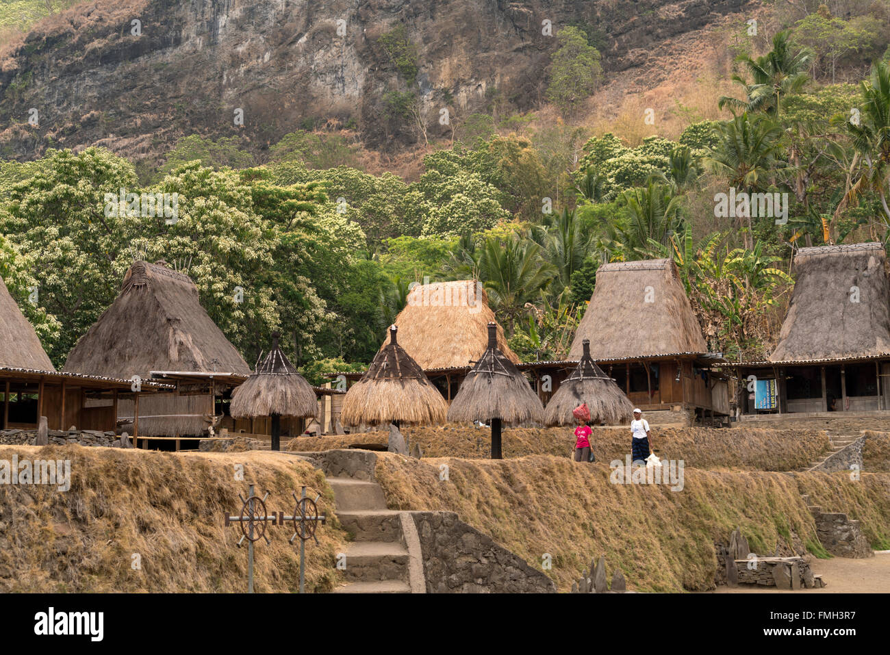 traditional high thatch-roofed houses and shrines in the Ngada village Bena near Bajawa, Flores, Indonesia, Asia - Stock Image