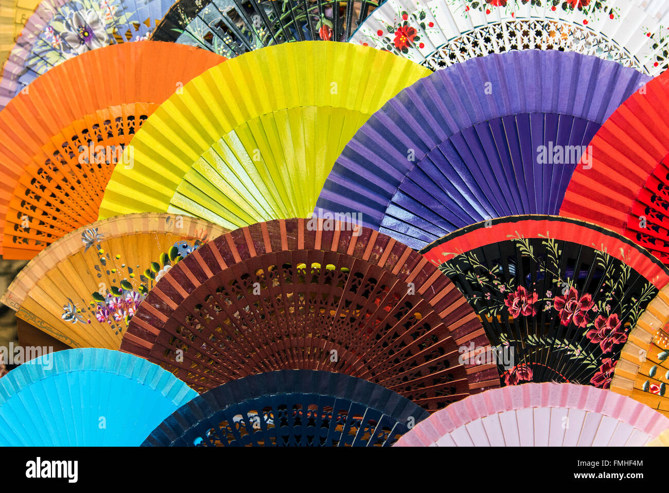Selection of souvenir Spanish fans for sale in Seville, Andalusia, Spain - Stock Image