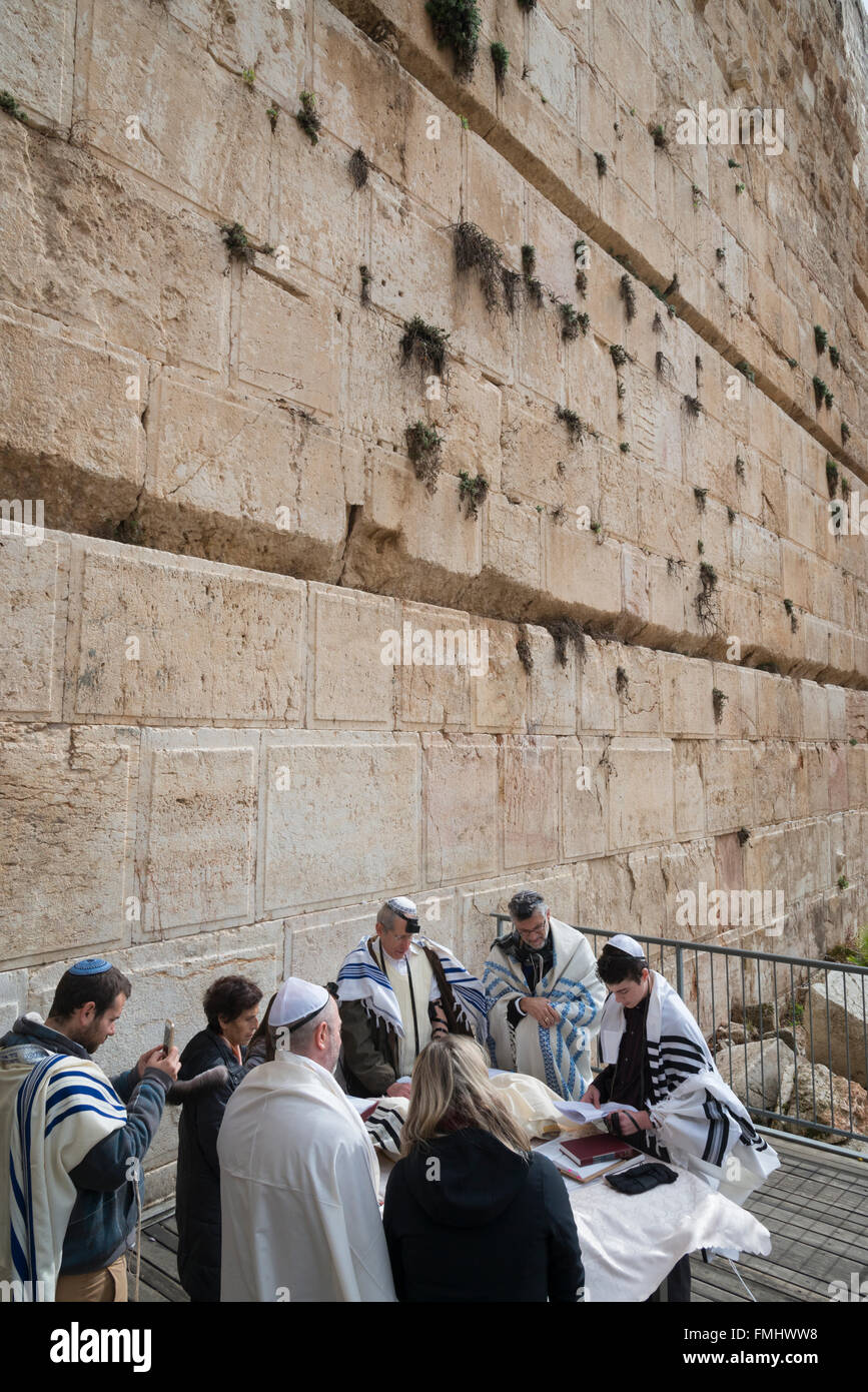 Jews with prayer shawls praying at Robinson's Arch. western Wall. Israel. - Stock Image