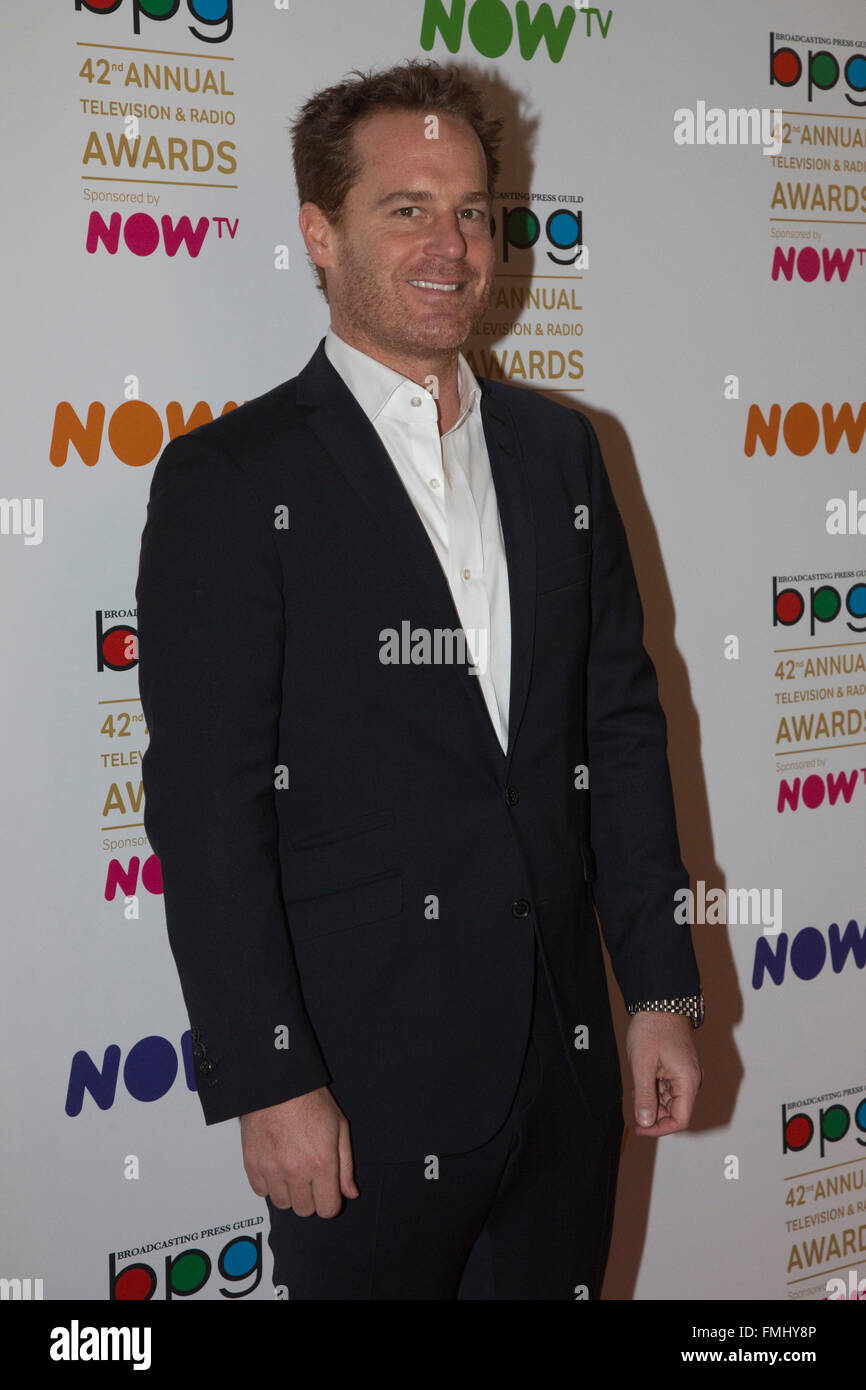 London, UK. 11 March 2016. Actor Adam James. Celebrities red carpet arrival for the 42nd Television and Radio Awards - Stock Image