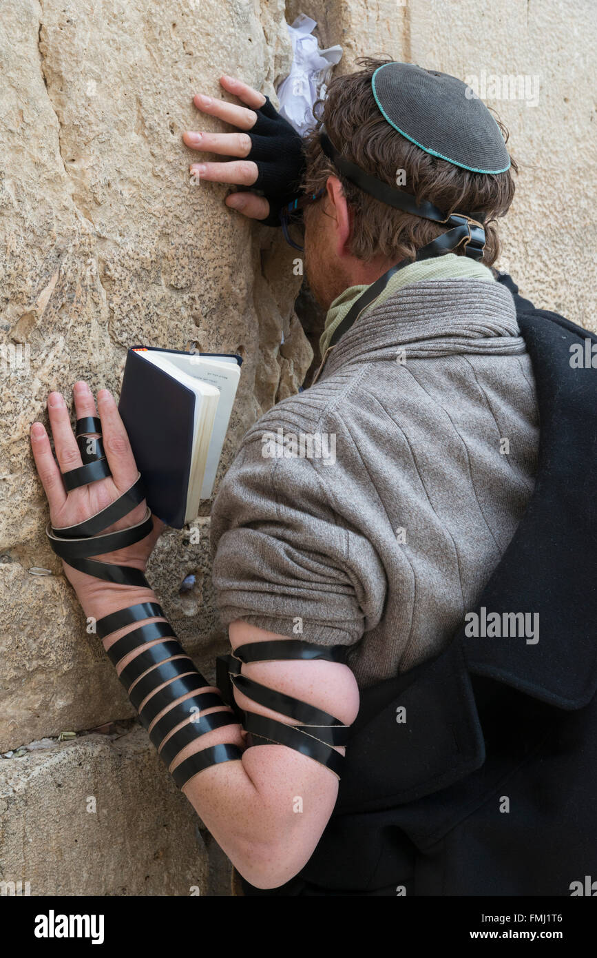 Jew with phylacteries  praying at the Western Wall. Jerusalem Old City. Israel. Stock Photo