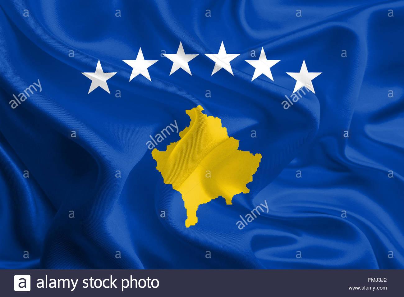 Waving Fabric Flag of Kosovo Stock Photo