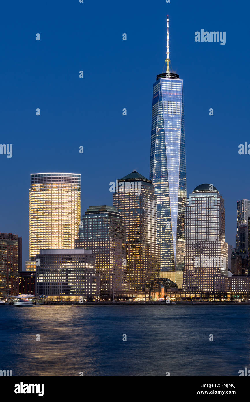 One World Trade Center (Freedom Tower) and World Financial Center at twilight in the Financial District of New York - Stock Image