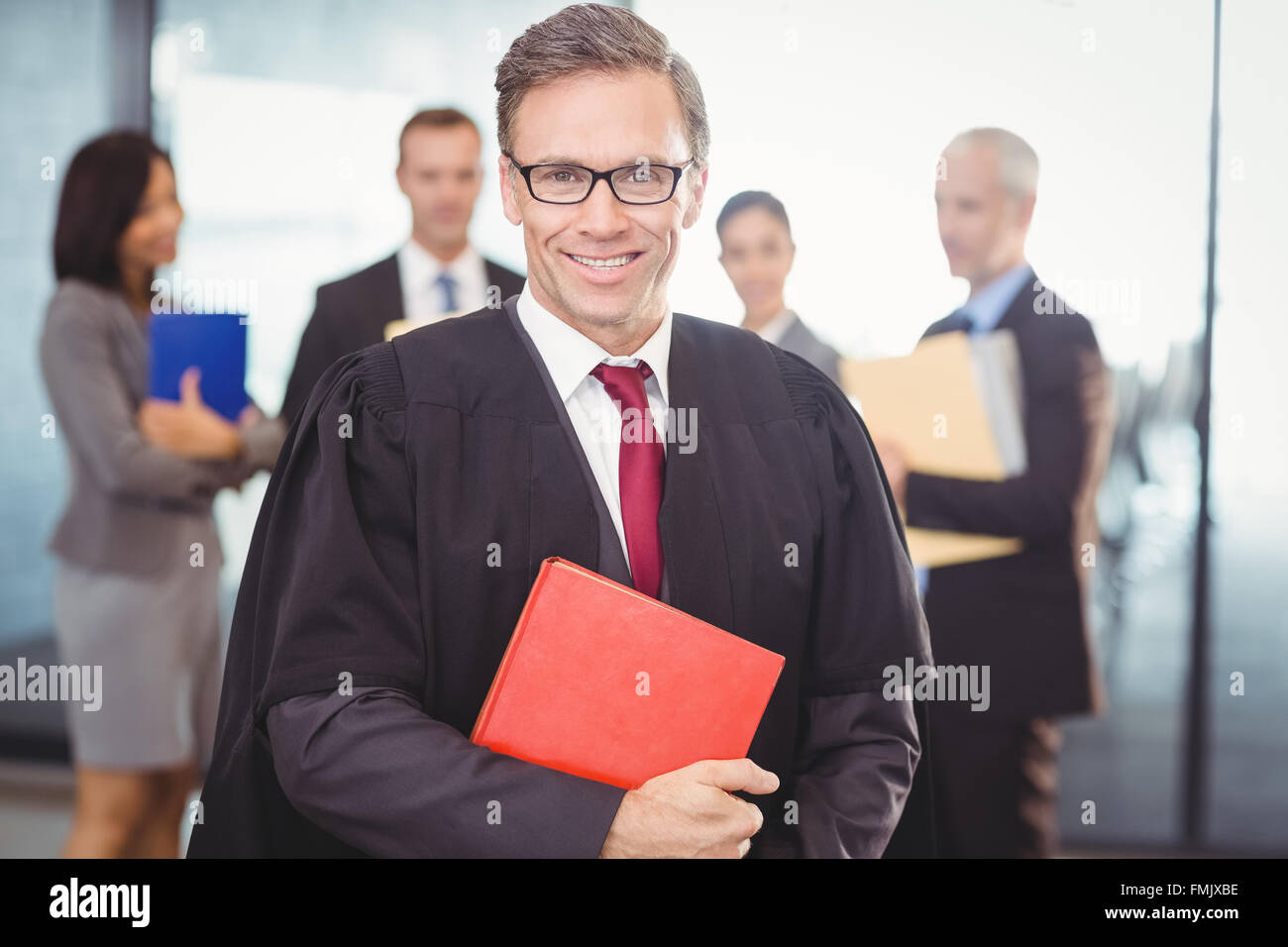 Lawyer holding a law book - Stock Image