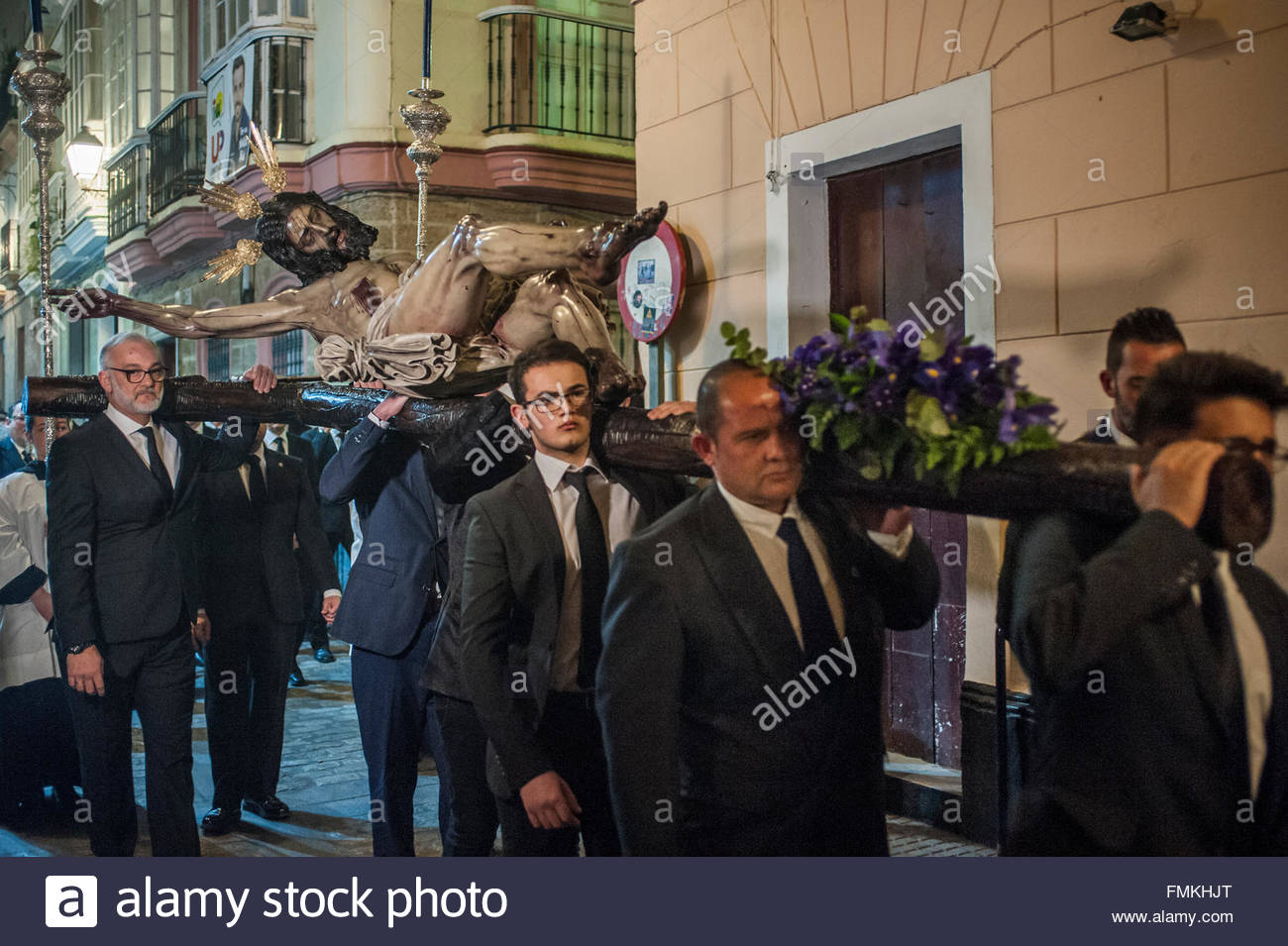 Cadiz, Spain. 11th Mar, 2016. A local Brotherhood of Penitents carries an effigy of Christ being deposited from - Stock Image