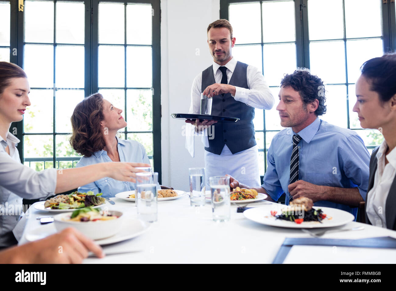 Waiter Serving Food Restaurant High Resolution Stock Photography And Images Alamy