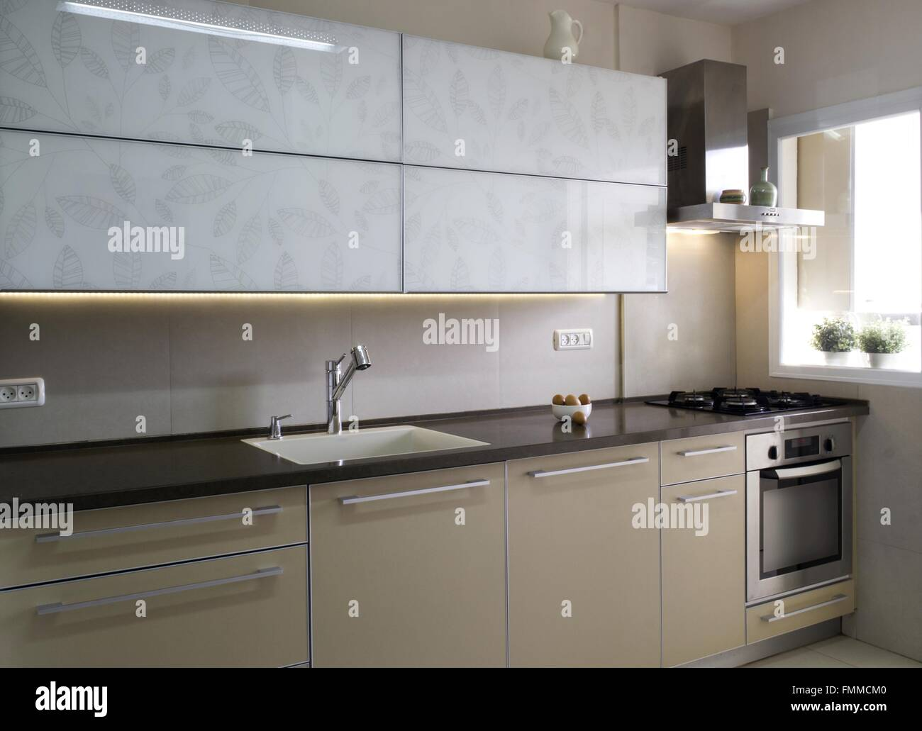 captivating beige gloss kitchen | Modern kitchen interior in beige and cream colors Stock ...