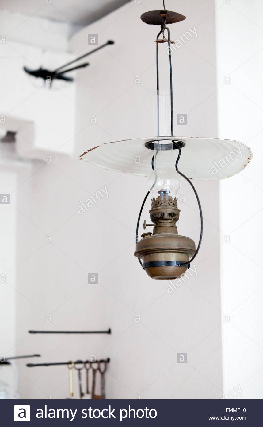 Old oil lamp in old kitchen - Stock Image