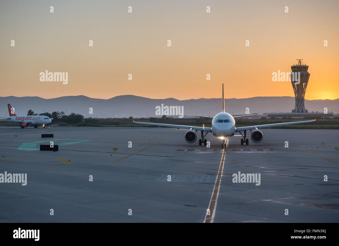 passenger airliners on El Prat Airport in Barcelona, Spain - Stock Image