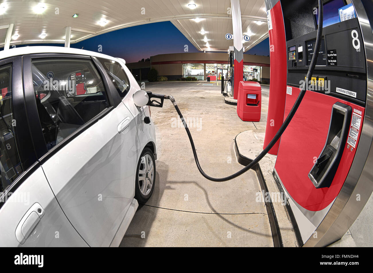 Refueling Small Economy Car At Gasoline Station - Stock Image