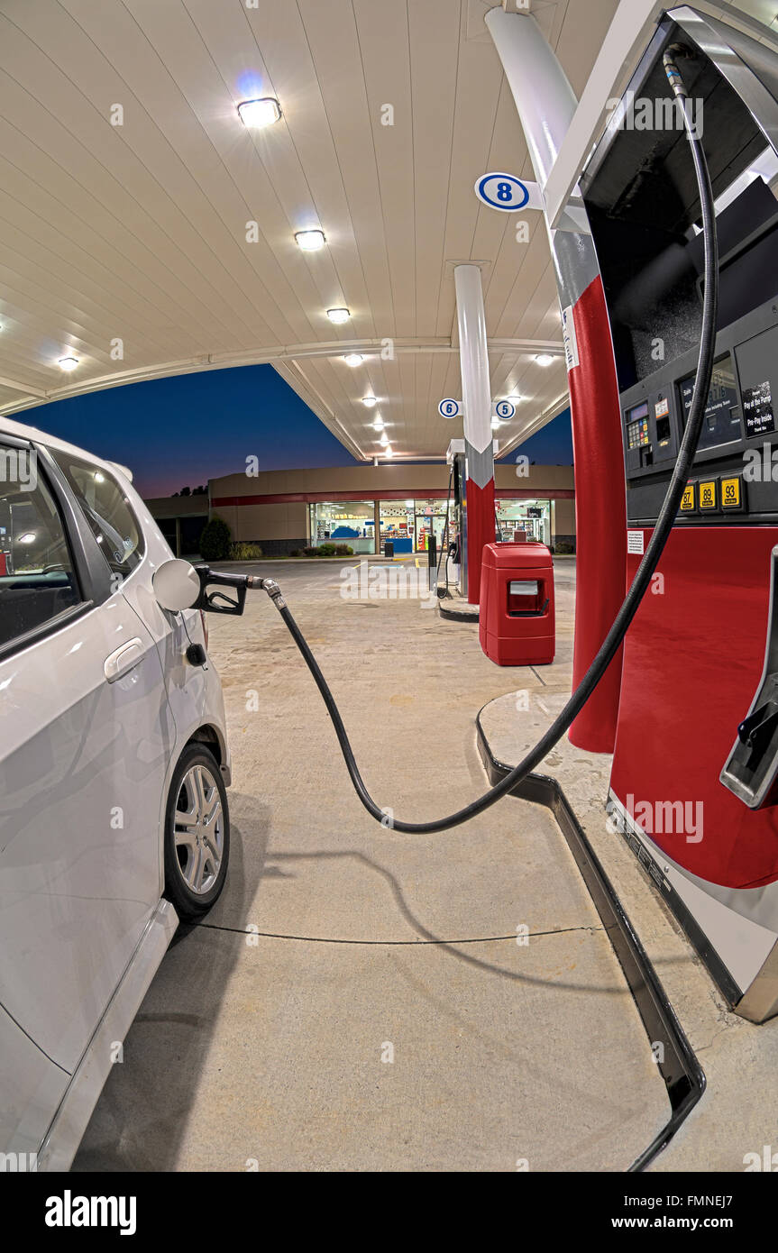 Small Car Refueling At Gasoline Station Convenience Store - Stock Image