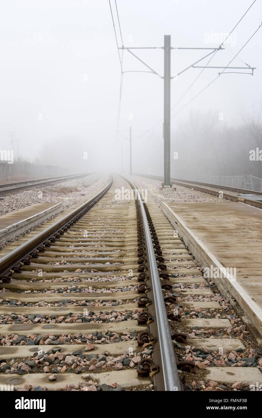 Train Tracks Disappear Into Fog - Stock Image