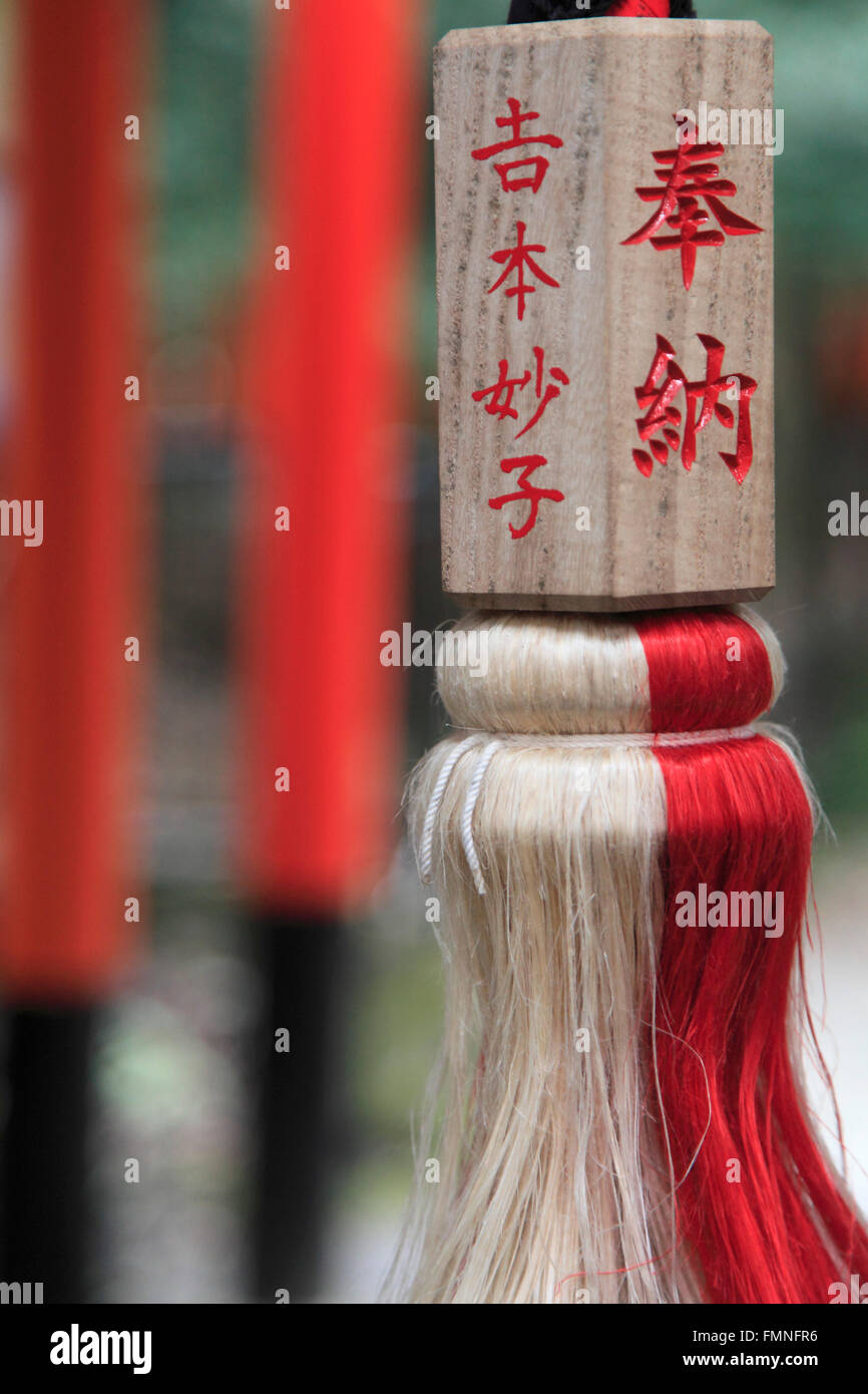 Japan; Kyoto; Fushimi Inari Taisha Shrine, cord, woodblock inscription, - Stock Image