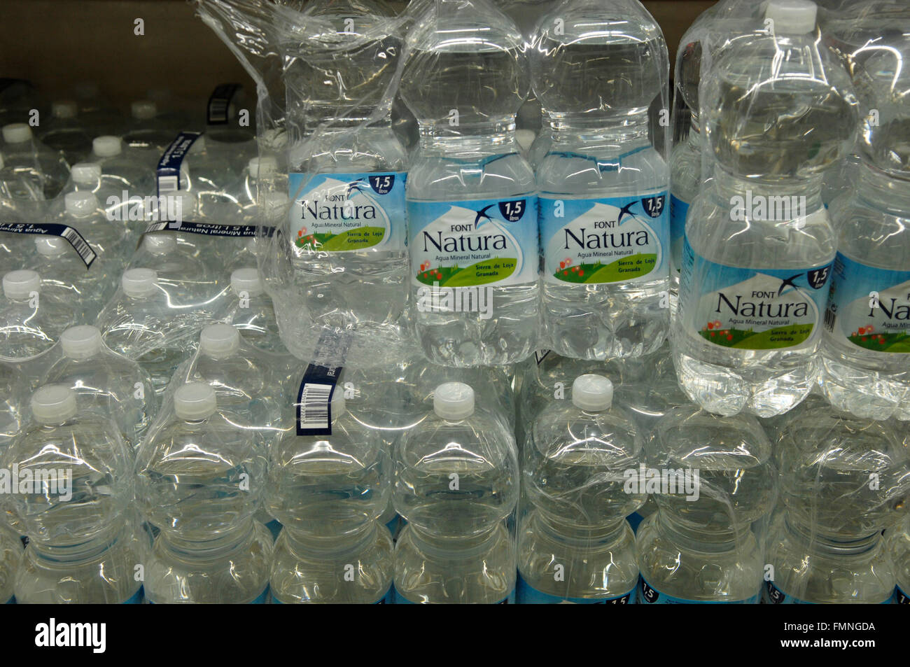 A close up image of natural water comes in 4 packs 1.5 litres each - Stock Image