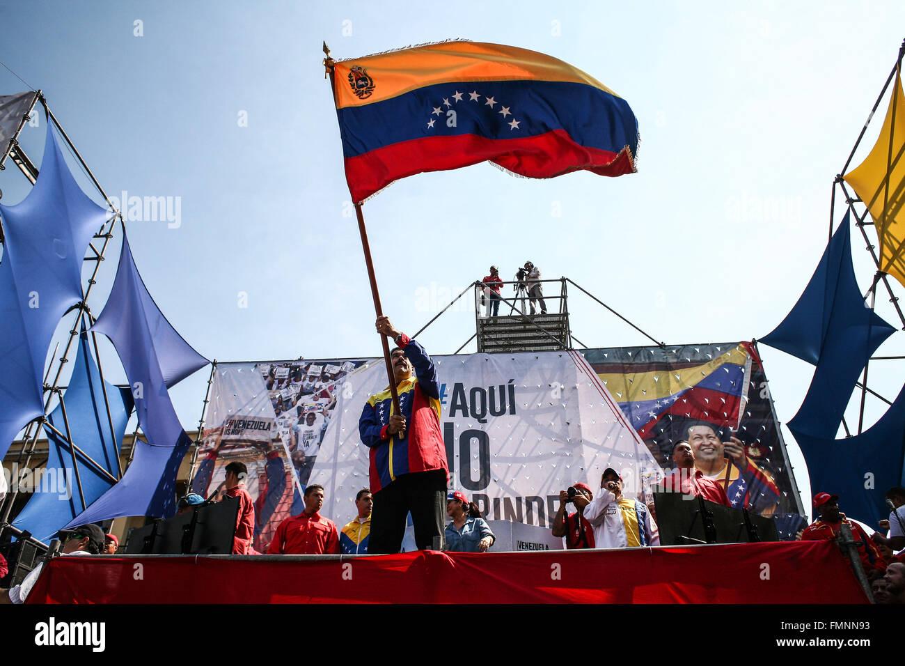 Caracas, Venezuela. 12th Mar, 2016. Venezuela's President Nicolas Maduro(C) waves a Venezuelan national flag - Stock Image