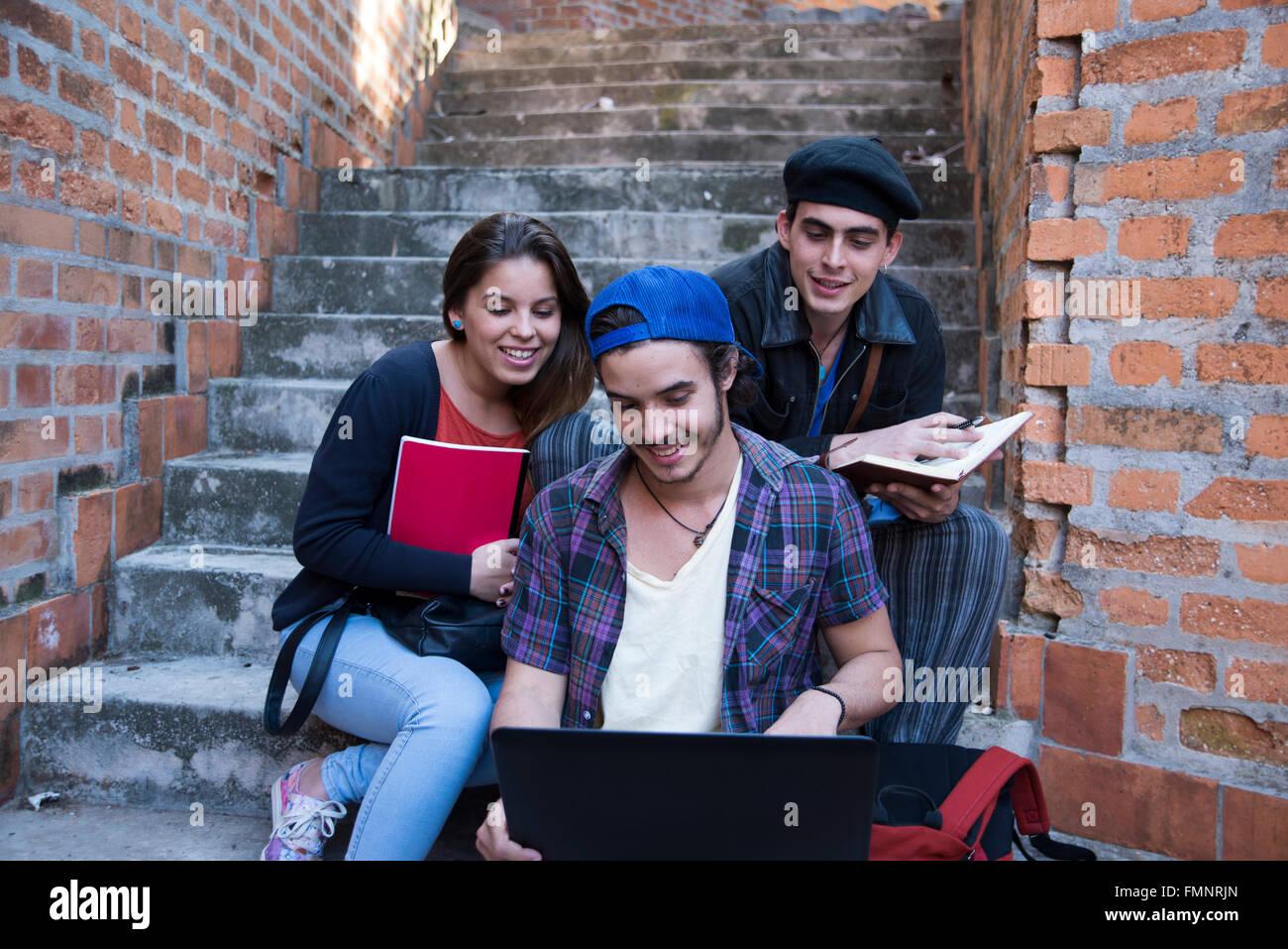 Three college students - Stock Image