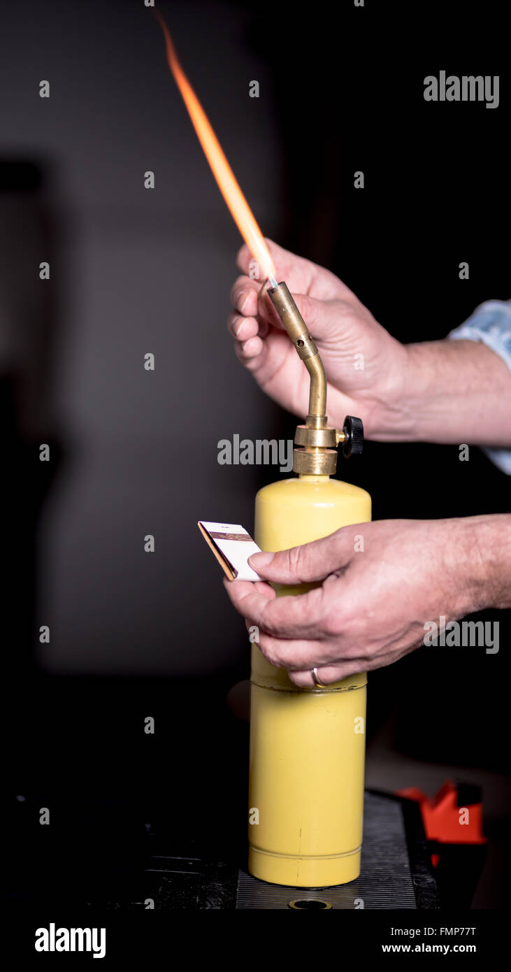 https www alamy com stock photo lighting a propane torch with a paper match 98833612 html