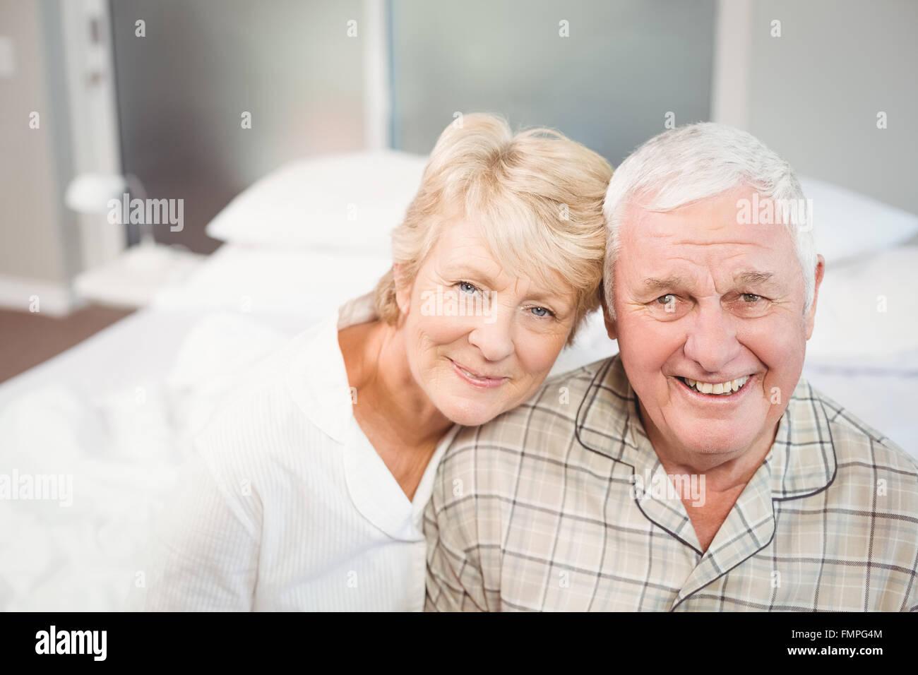 Portrait of happy senior couple in nightwear - Stock Image