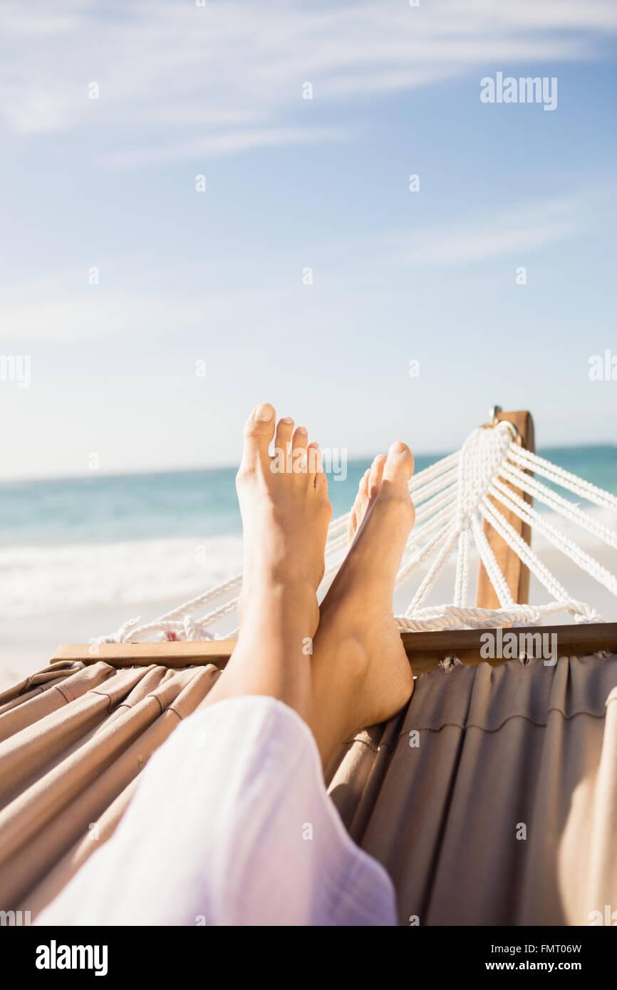 Woman lying in hammock - Stock Image