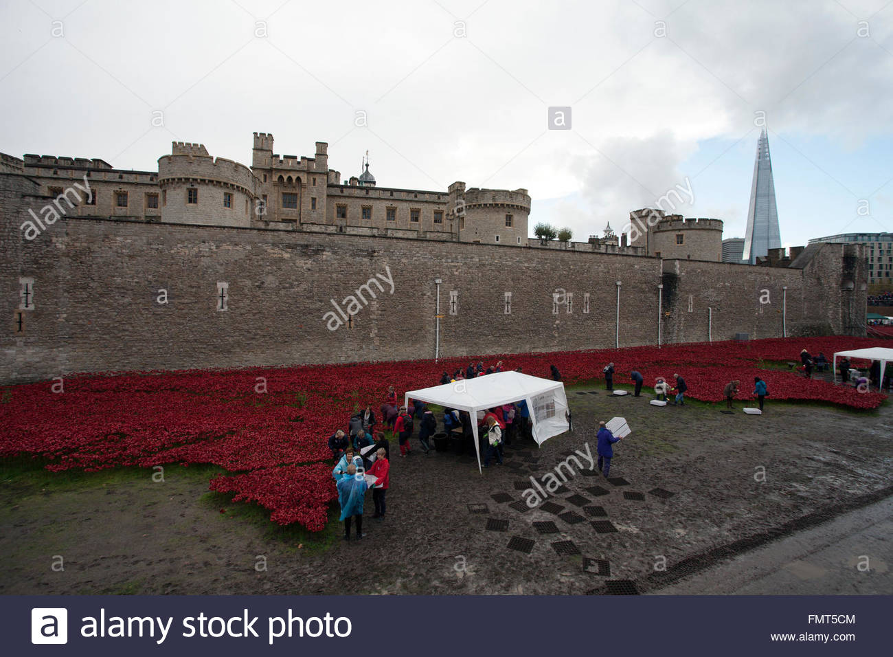 Some of 8.000 volunteers dismantling the Blood Swept Lands and Seas of Red exhibit, Tower of London, The Shard, Stock Photo