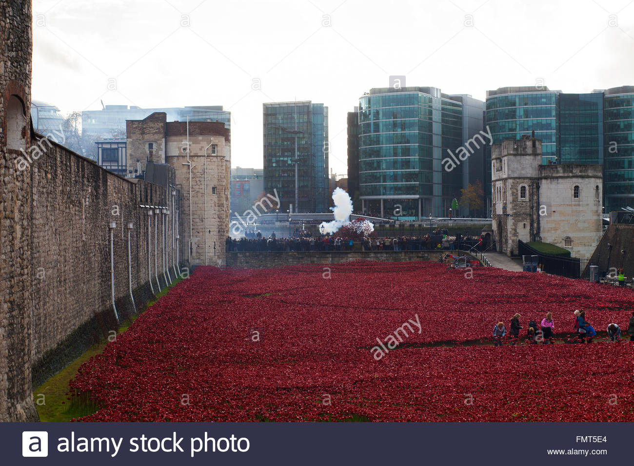 Some of 8.000 volunteers dismantling the Blood Swept Lands and Seas of Red exhibit, smoke from gun salute, Tower - Stock Image