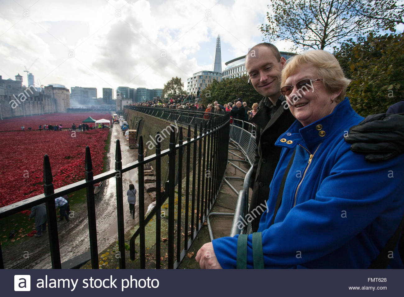 Mother and son, spectators, gun salute, Dismantling of the Blood Swept Lands and Seas of Red exhibit, the Tower - Stock Image