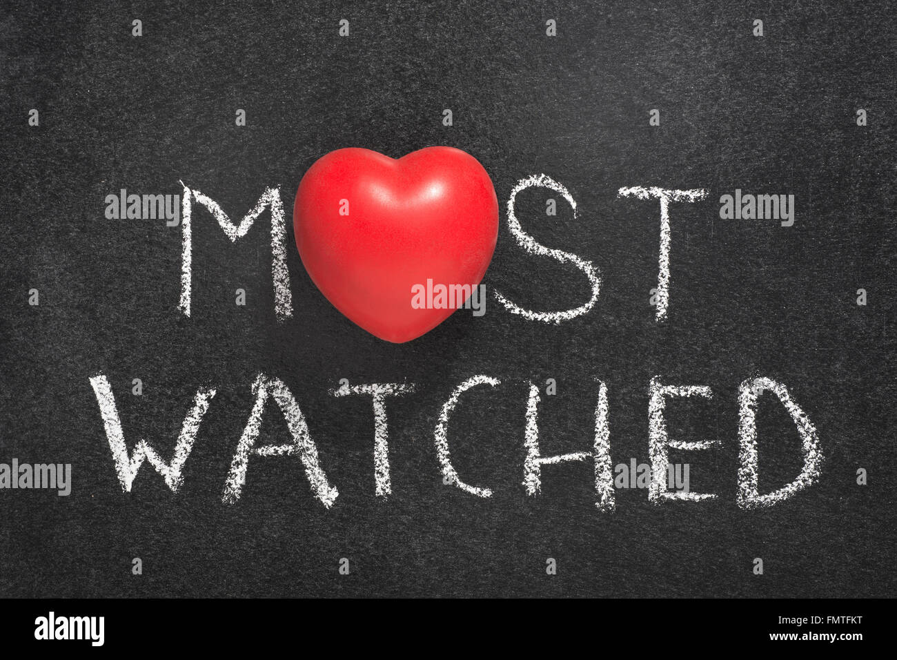 most watched phrase handwritten on blackboard with heart symbol instead of O - Stock Image