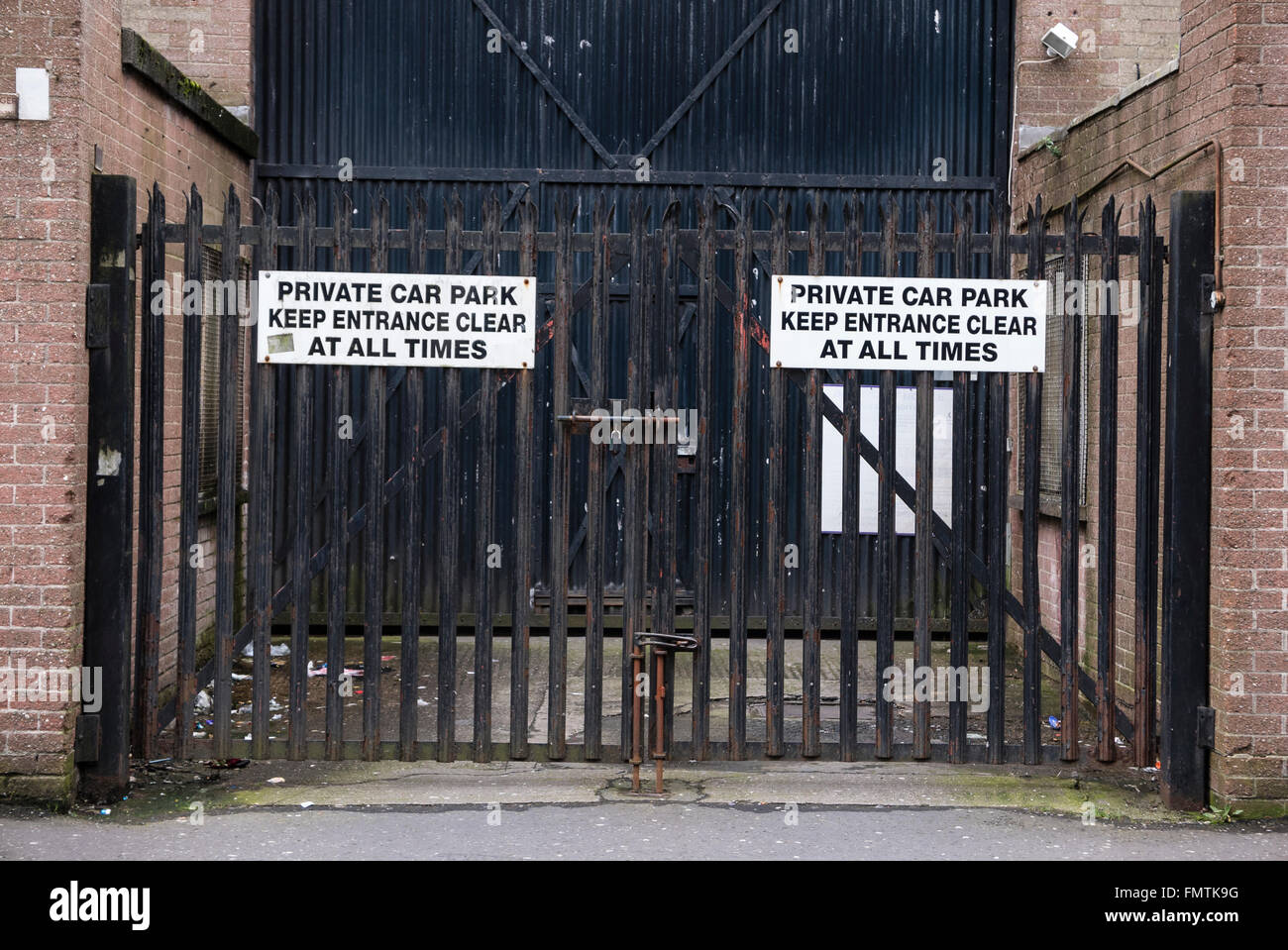 """Security Gates with signs saying """"Private car park. Keep entrance clear at all times"""". Stock Photo"""