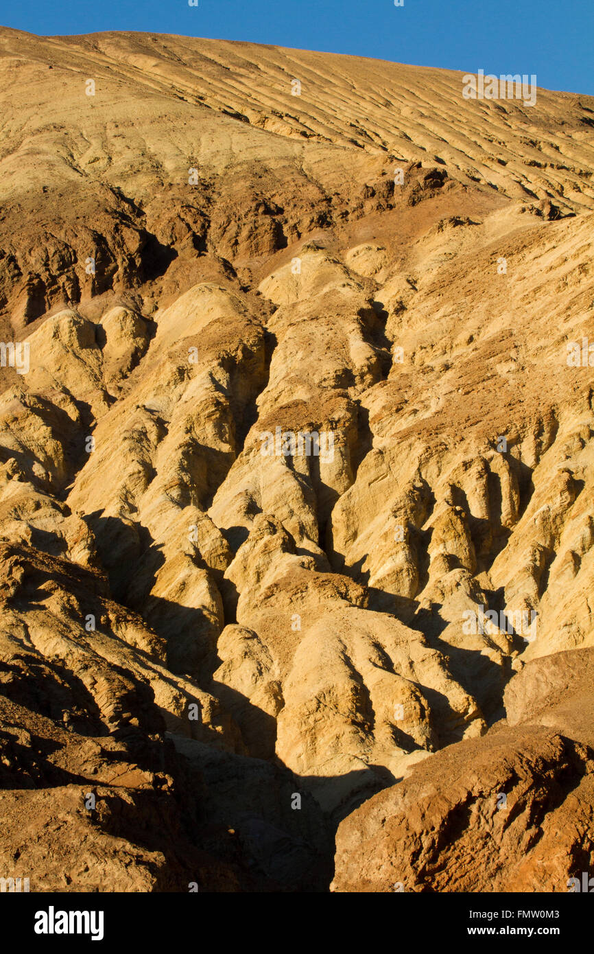 Geologic forms in late afternoon sun along Badwater Road, Death Valley, CA - Stock Image