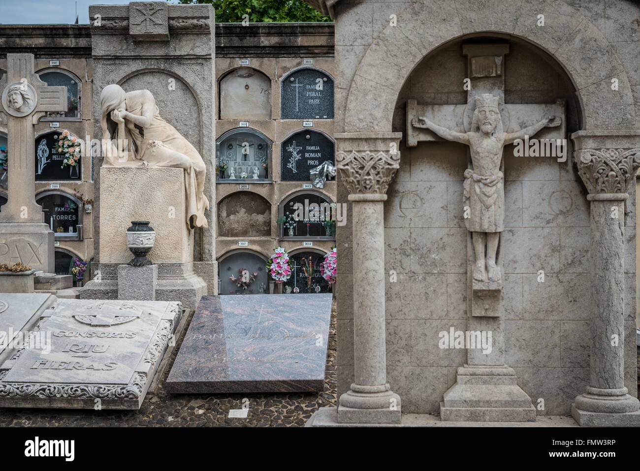 Graves at Poblenou Cemetery - Cementiri de l'Est (East cemetery) in Barcelona, Spain Stock Photo