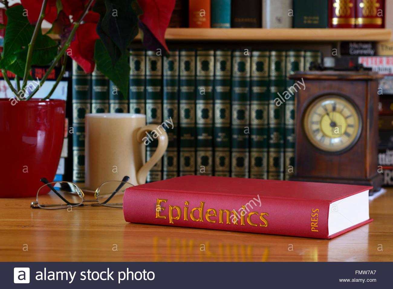 Epidemics book on study desk, Dorset, England, Britain, UK - Stock Image